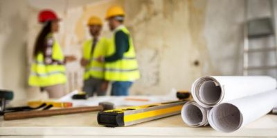 Construction concept. blueprint, level and rulers, closeup